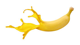 Yellow banana with paint splash Royalty Free Stock Photography
