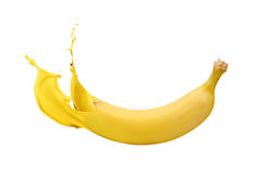 Yellow banana with paint splash Royalty Free Stock Images