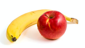 Yellow banana and ripe red apple Stock Photography
