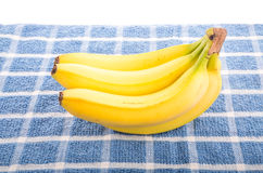 Yellow Bananas on Blue Towel. A bunch of yellow bananas on a blue towel Stock Photography