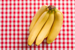 Yellow bananas on checkered tablecloth Royalty Free Stock Photography