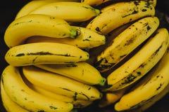 Yellow bananas. Fresh ripe yellow bananas in wicker basket on wooden background Stock Photography
