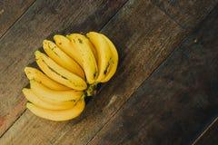 Yellow bananas. Fresh ripe yellow bananas, on wooden background Stock Image