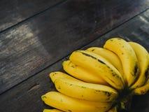 Yellow bananas. Fresh ripe yellow bananas, on wooden background Royalty Free Stock Photo