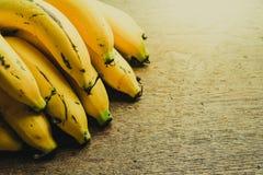 Yellow bananas. Fresh ripe yellow bananas, on wooden background Royalty Free Stock Photos