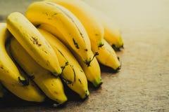 Yellow bananas. Fresh ripe yellow bananas, on wooden background Stock Images