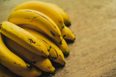 Yellow bananas. Fresh ripe yellow bananas, on wooden background Royalty Free Stock Photography