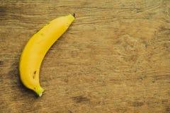 Yellow bananas. Fresh ripe yellow bananas, on wooden background Stock Photos