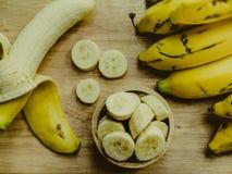 Yellow bananas. Fresh ripe yellow bananas, on wooden background Royalty Free Stock Image