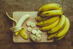 Yellow bananas. Fresh ripe yellow bananas, on wooden background Stock Photography