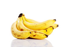 Yellow bananas lying on white. Royalty Free Stock Photos