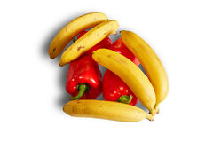 Yellow bananas and red pepper on white background with shadow Stock Photo