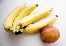 Yellow bananas with ripe nectarin. Yellow bananas and ripe nectarin are healthy food. You can use for muesli. Its a delicious breakfast. Mediterran fruits in Stock Photos