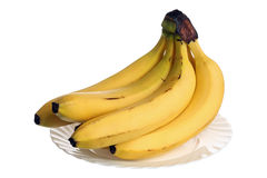 Bananas over plate Stock Photo