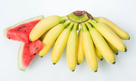 Yellow bananas with slices of watermelon Royalty Free Stock Image