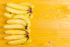 Yellow bananas on a yellow board to the right place for your tex Stock Photos