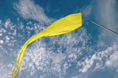 Yellow banner. Against the sky royalty free stock images