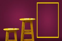 Yellow bar stool with magenta background royalty free stock photography
