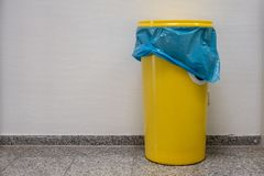 Yellow barrel with a lid stands in the hallway royalty free stock photo