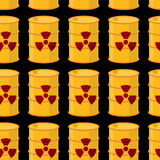 Yellow barrels of radioactive substance seamless pattern. Vector Stock Photo