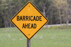 Yellow Barricade Ahead Sign. Worn with weather royalty free stock photo