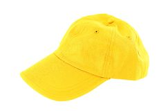 Yellow baseball cap. Isolated on white royalty free stock images