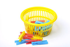 Yellow basket with clothes pegs Royalty Free Stock Photo