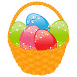 Yellow basket with colored eggs Stock Photography