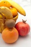 Yellow basket with mandarin oranges, bananas Royalty Free Stock Image