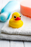 Yellow bath duck on white towel Stock Photography