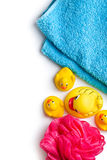 Yellow bath ducks and bath puff Stock Photo