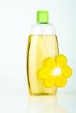 Yellow bath set. Botlle of yellow shampoo with sponge flower Stock Images