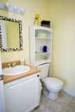 Yellow Bathroom. A nice yellow bathroom with sink and toilet royalty free stock photography