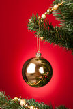 Yellow Bauble On Christmas Tree Royalty Free Stock Image