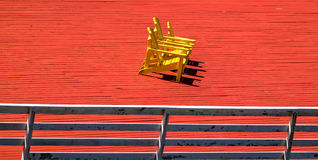 Yellow Beach Adirondack Chair Stock Photo