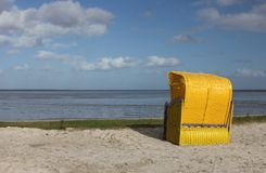 Yellow beach chair on the North Sea Stock Photo