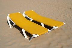 Yellow Beach Chairs. Two yellow beach chairs on the beach Stock Photo