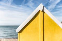 Yellow beach hut on coast in Kent, England. Summer beach hut in England Royalty Free Stock Photos