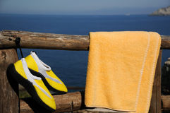 Yellow Beach Shoes and Towel Stock Images