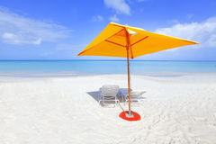 Yellow beach umbrella Stock Image