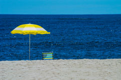 Yellow Beach Umbrella. Abeach umbrella and chair on Long Beach Island along the Jersey shore Royalty Free Stock Images