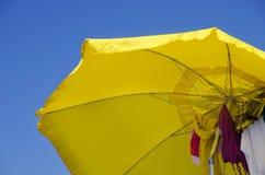 Yellow beach umbrella Stock Images