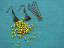 Yellow beads and pieces for making earrings, handmade jewelry Royalty Free Stock Image