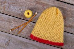 Yellow beanie, spool and Royalty Free Stock Photo