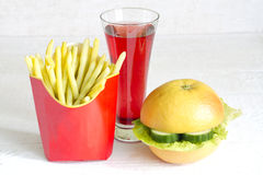 Yellow beans and grapefruit like hamburger Stock Photography