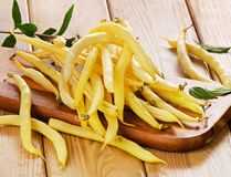 Yellow beans on  wooden board Royalty Free Stock Photography