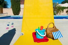 Yellow bed at swimming pool Stock Images