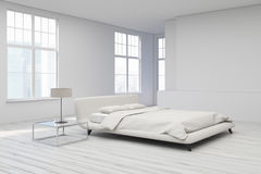 Yellow bed, white floor corner Stock Photography