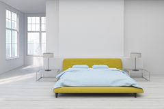 Yellow bed, white floor Royalty Free Stock Image