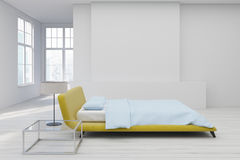 Yellow bed, white floor side Royalty Free Stock Images